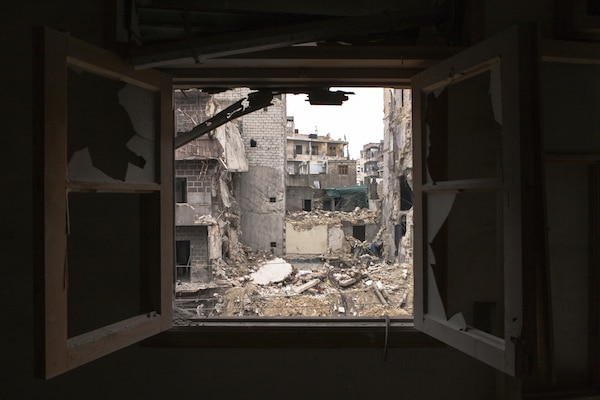 A building that was being used as a makeshift hospital in Aleppo. Picture taken from across the street from the upper floor of a now abandoned residential block. © Richard Harvey | dreamstime.com