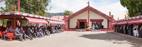 The Turangawaewae Marae, the sacred complex for the Maoris and HQ for the Maori King. The Maori King can be seen seated beside the Khalifah of the Promised Messah in this historic meeting.