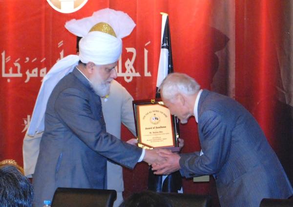 Mr Akio Najima, Prominent Lawyer and Human Rights Activist greeting His Holiness Mirza Masroor Ahmad