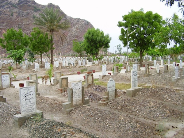 According to the Founder of the Ahmadiyya Muslim Community, a holy person maintains a connection with the grave and this material world for a few days after death. However the soul still immediately reaches its destination at death and does not remain in the body. Photo: General photo of the Bahishti Maqbara, Ahmadiyya Muslim Community Graveyard in Rabwah, Pakistan.