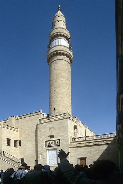 The minaret of the mosque of Prophet Jonahas in Nineveh, Mosul. Jonahas was known for his just and pious nature, which allowed him to comprehend his errors and sincerely repent before God. Thus, his prayers delivered him from his predicament. (Accessed via Wiki Commons)