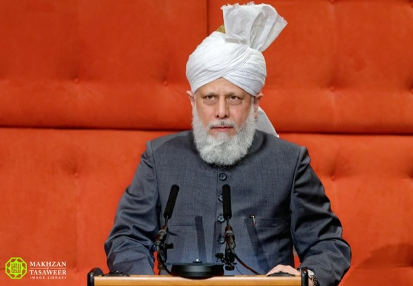His Holiness, Hazrat Mirza Masroor Ahmadaba spoke to the audience at a special reception in Copenhagen, Denmark. © Makhzan-e-Tasaweer