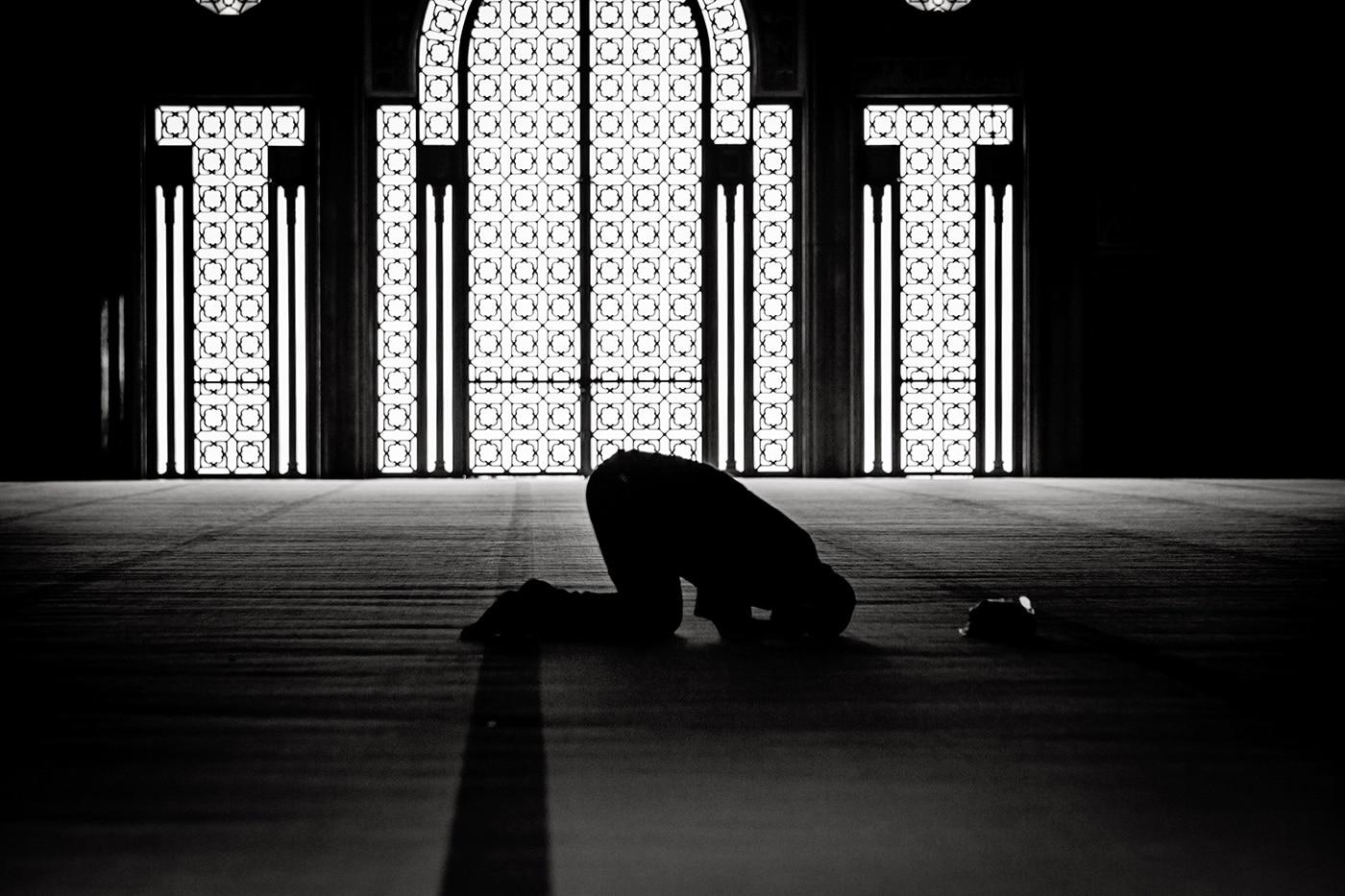 Muslim man praying in the mosque