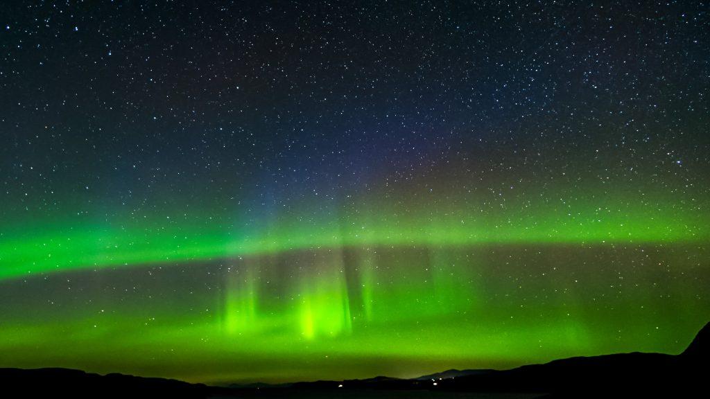 The Northern Lights (Aurora Borealis) seen over the Isle of Skye, Scotland.